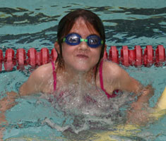 Student wearing goggles in pool