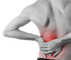 a person touching their back where they are experiencing pain