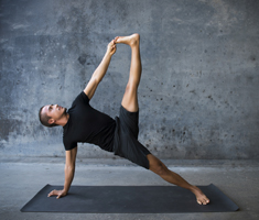 man does yoga on a mat