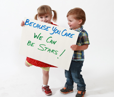 Children holding a because you care sign