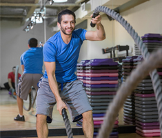 MNjcc personal trainer Aviv playing with battle ropes