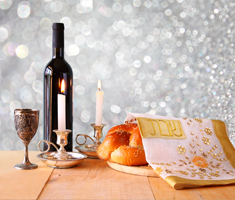 a table with wine, a candle and bread