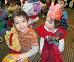 Two kids in Purim costumes