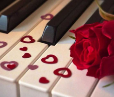 Piano keys with heart shaped glitter and a rose on top